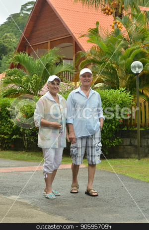 Senior couple at  hotel resort stock photo, Senior beautiful couple walking at tropic resort by Ruslan Huzau