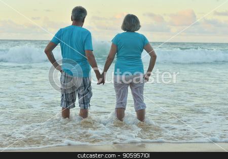 Happy elderly couple resting stock photo, Happy elderly couple resting on tropical  beach by Ruslan Huzau