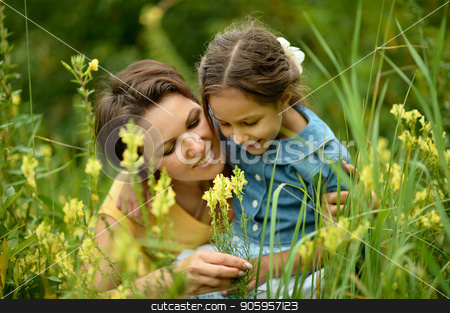 mother and daughter at field stock photo, happy mother and daughter at summer field by Ruslan Huzau