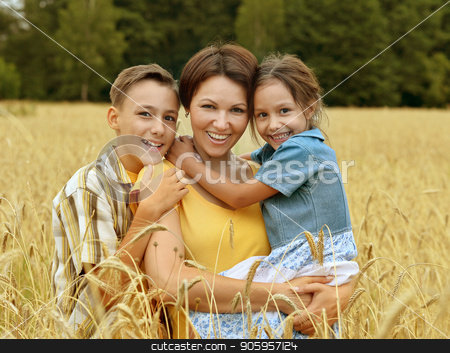 happy family outdoor stock photo, happy mother and children at summer wheat field by Ruslan Huzau
