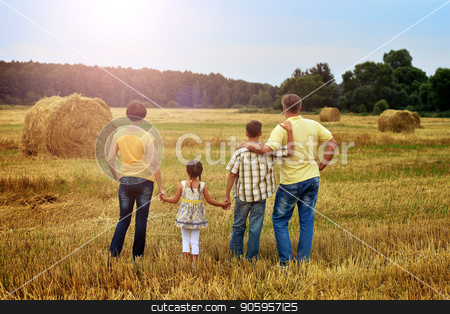 Happy family in wheat field stock photo, Rear view of family standing on wheat field in sunny day by Ruslan Huzau