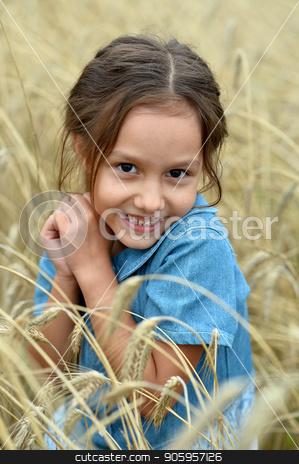 cute Little Girl in wheat field  stock photo, cute beautiful Little Girl in wheat field by Ruslan Huzau