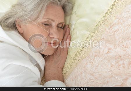 Beautiful older woman sleeping stock photo, Beautiful older woman sleeping in the bedroom by Ruslan Huzau