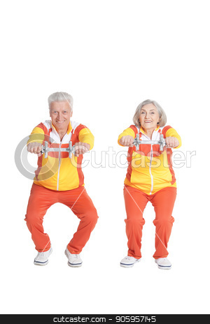 Active smiling senior couple stock photo, Active smiling senior couple exercising isolated on white by Ruslan Huzau