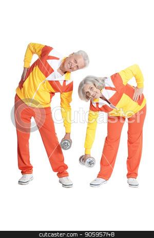 Active smiling senior couple stock photo, Active smiling senior couple exercising isolated on white by Ruslan Huzau