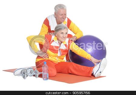 Portrait of Senior Couple Exercising stock photo, Portrait of Senior Couple Exercising On White Background by Ruslan Huzau