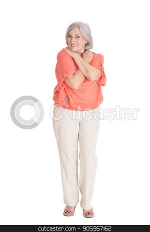 Portrait of beautiful senior woman stock photo, Portrait of beautiful senior woman in pink shirt posing isolated on white background by Ruslan Huzau
