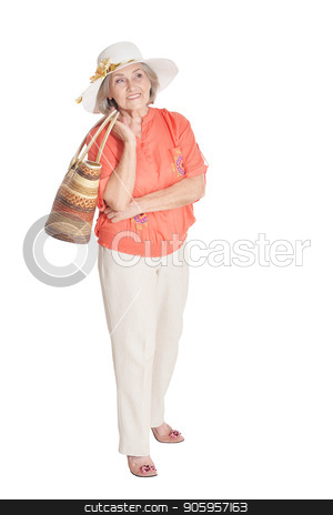 Portrait of beautiful senior woman stock photo, Portrait of beautiful senior woman wearing pink shirt and white hat posing isolated on white background by Ruslan Huzau