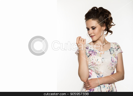 young elegant woman with professional hairstyle poses on a white background. free space for your text stock photo, young elegant woman with professional hairstyle poses on a white background. by Alexander