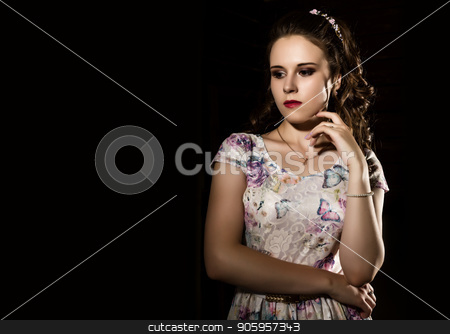 young elegant woman with professional hairstyle poses on a white background. free space for your text stock photo, young elegant woman with professional hairstyle poses on a white background by Alexander