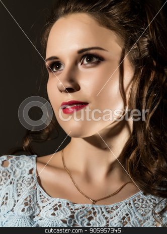 young elegant woman with professional hairstyle poses on a dark background. stock photo, young elegant woman with professional hairstyle poses on a dark background by Alexander