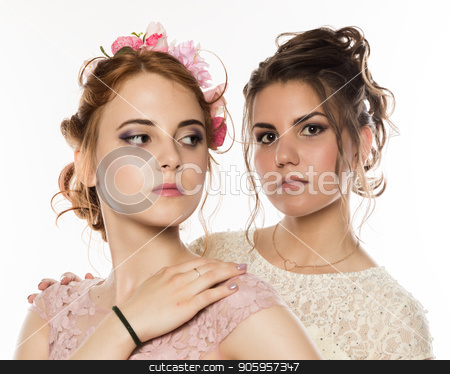 Two happy beautiful young women in elegant dresses, tender history stock photo, Two happy beautiful young women in elegant dresses, tender history. by Alexander