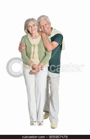 portrait of  senior couple embracing  isolated stock photo, Full length portrait of  senior couple embracing  isolated on white background by Ruslan Huzau