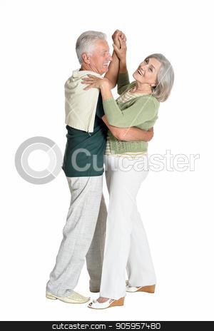 portrait of  senior couple dancing stock photo, portrait of  senior couple dancing  isolated on white background by Ruslan Huzau