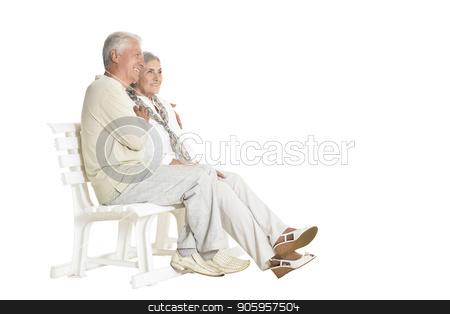 portrait of  senior couple sitting on bench stock photo, portrait of  senior couple sitting on bench  isolated on white background, full length by Ruslan Huzau