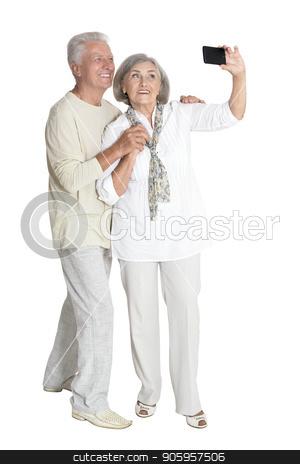 portrait of  senior couple taking selfie  stock photo, portrait of  senior couple taking selfie  isolated on white background, full length by Ruslan Huzau