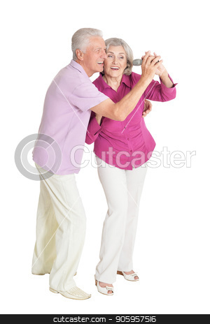happy senior couple stock photo, Portrait of a happy senior couple singing  with microphone at white background by Ruslan Huzau