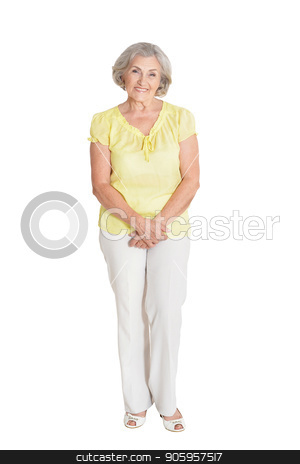 Portrait of beautiful senior woman stock photo, Portrait of beautiful senior woman in yellow blouse posing isolated on white background by Ruslan Huzau