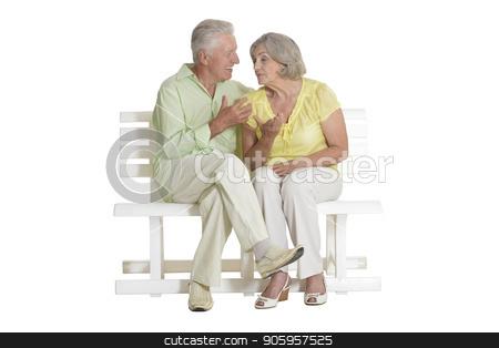 sad senior couple sitting on bench stock photo, sad senior couple sitting on bench and talking  isolated on white background by Ruslan Huzau