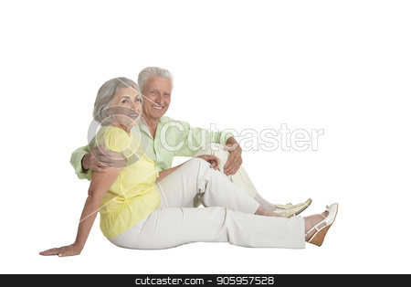 portrait of  senior couple hugging stock photo, portrait of  senior couple sitting and hugging  isolated on white background, full length by Ruslan Huzau