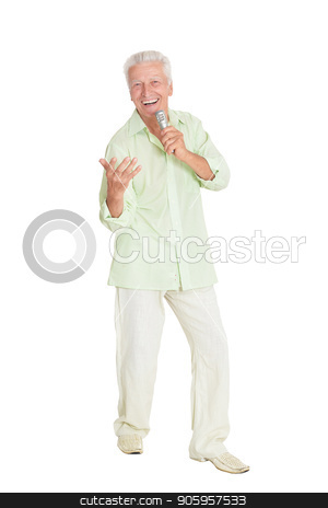mature man with microphone stock photo, Senior man singing with microphone posing against white background by Ruslan Huzau