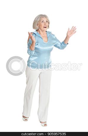 Portrait of beautiful senior woman stock photo, Portrait of beautiful senior woman in blue blouse posing isolated on white background by Ruslan Huzau