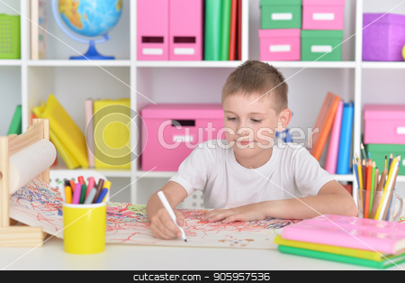 cute little boy drawing stock photo, cute little boy drawing at home or kindergarten by Ruslan Huzau