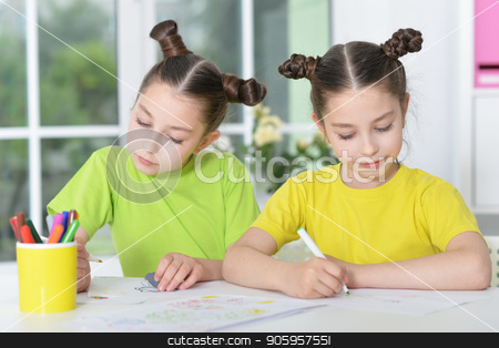 girls  on lesson of art stock photo, portrait of Cute twin sisters drawing together at home by Ruslan Huzau