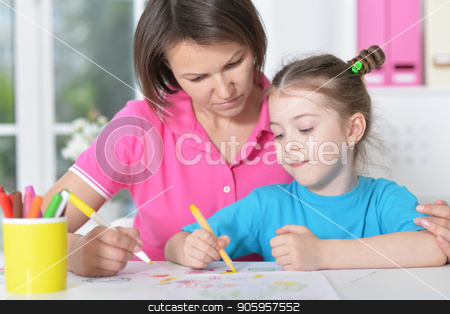 woman and  girl with colored pencils stock photo, Smiling  woman and a young girl with colored pencils by Ruslan Huzau