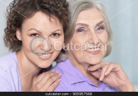 Senior woman with daughter stock photo, Portrait of senior woman with adult daughter at home by Ruslan Huzau