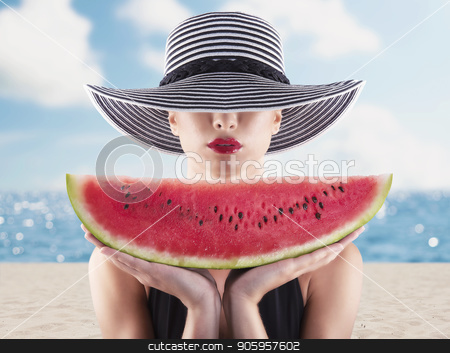 Girl in swimsuit with red watermelon in hand stock photo, Girl in swimsuit with fresh red watermelon in hand by Federico Caputo