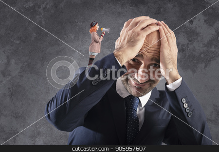 Clown that shuts with megaphone to a businessman stock photo, Small clown that shuts with megaphone to a businessman by Federico Caputo