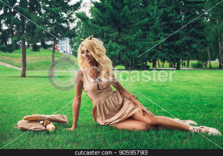 Beauty blonde alone young woman resting in the park stock photo, Rest in park, food, and people concept - beauty blonde young woman resting in the park by olinchuk