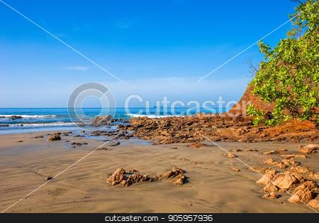 Rocky Beach Wet Sand stock photo, A rocky beach on wet sand at low tide by Darryl Brooks