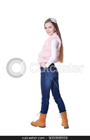 Happy little girl in jeans  posing  stock photo, Happy little girl in jeans  posing  isolated on white background by Ruslan Huzau