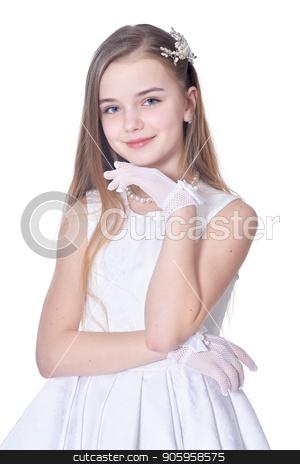 Happy little girl in beautiful white dress posing stock photo, Happy little girl in beautiful white dress posing  isolated on white background by Ruslan Huzau