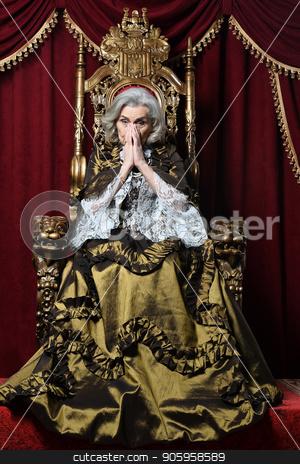 beautiful senior woman Queen stock photo, beautiful senior woman Queen posing on throne by Ruslan Huzau