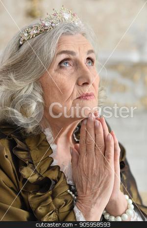Portrait of beautiful senior woman Queen stock photo, Portrait of beautiful senior woman Queen posing indoors by Ruslan Huzau