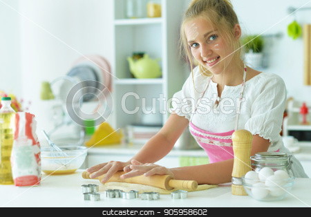 young girl in the kitchen stock photo, young girl in the kitchen making cookies by Ruslan Huzau