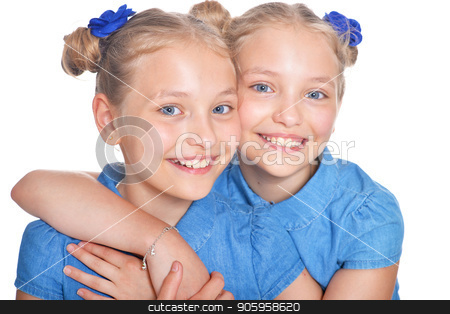 two adorable twin sisters stock photo, two adorable twin sisters posing isolated on white background by Ruslan Huzau