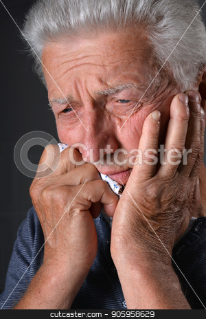 Portrait of Sad senior man stock photo, Portrait of Sad senior man on dark background by Ruslan Huzau
