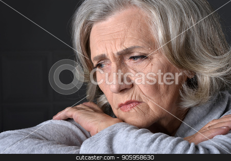 Close up portrait of tired senior woman stock photo, Close up portrait of tired senior woman at home by Ruslan Huzau