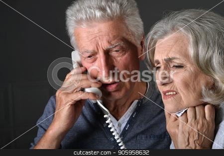Portrait of sick senior man calling stock photo, Portrait of sick senior man calling to hospital by Ruslan Huzau