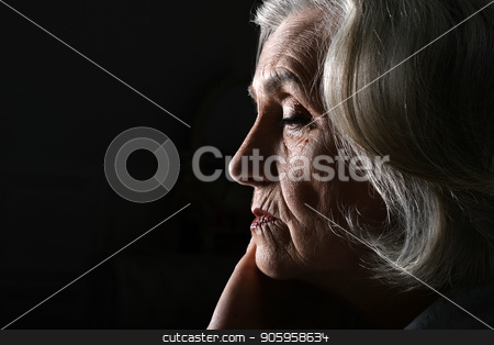 Close up portrait of tired senior woman stock photo, Close up portrait of tired senior woman at home by Ruslan Huzau