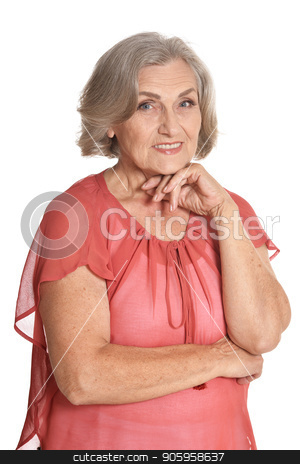 Portrait of senior woman in blue blouse posing stock photo, Portrait of senior woman in blue blouse posing isolated on white background by Ruslan Huzau