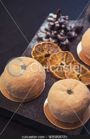 Tasty dessert for xmas stock photo, Tasty dessert as orange fruit with chocolate fir-tree for new year holiday by olinchuk