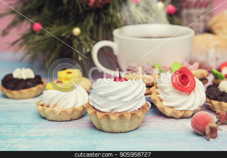Xmas cookie on table stock photo, Tasty cookie on a fir-tree background by olinchuk