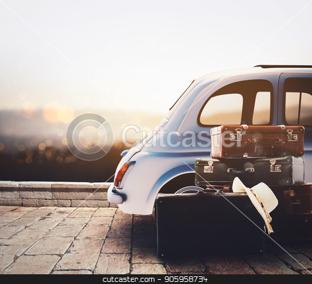 Car on the road ready for summer holiday during sunset with luggage stock photo, Leave with the car and luggage on vacation by Federico Caputo