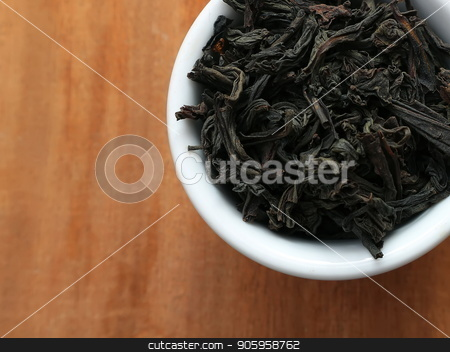 A cup of dry tea. Black tea. A cup of tea. stock photo, A cup of dry tea. Black tea. A cup of tea. Welding in a cup. by Oleksii Tim