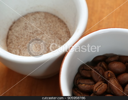 Coffee is soluble and in beans in a cup. stock photo, Coffee is soluble and in beans in a cup. Coffee in a cup without water. Just add water. by Oleksii Tim
